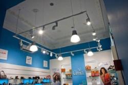 Вертикальная тросовая система в магазине